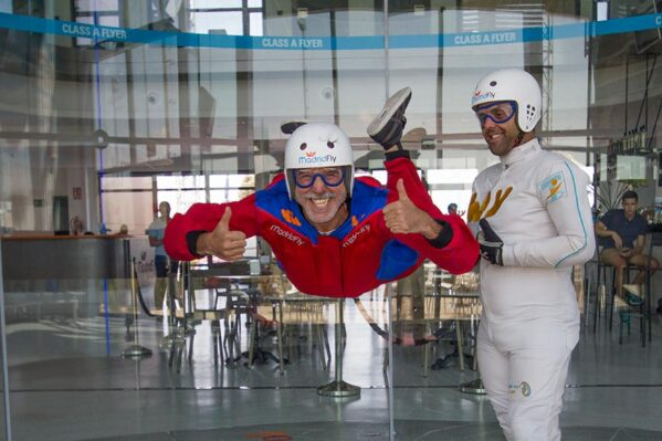 Image of people indoor skydiving