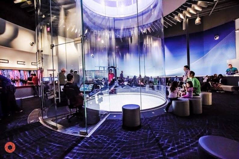 Some skydivers flying at iFLY Houston Woodlands.