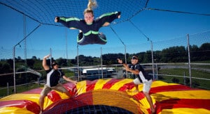 Two instructors helping a flyer at Freefall Xtreme