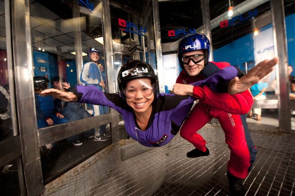 A woman enjoys her first flight in iFLY Orlando, Florida.