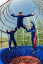 A flyer enjoys some tunnel time with two instructors in Kiev, Ukraine at Aerofly.
