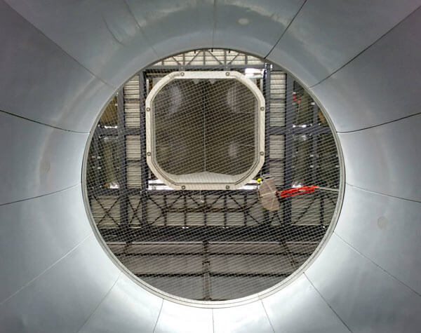 A shot from the bottom showing the view through the bell, up to the first turn in Paris.