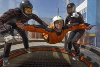 Two instructors help a student fly in Kiev.