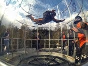 A first time flyer enjoying a flight in Maxfly vertical wind tunnel in Poland.