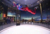 A first time flyer enjoys a high flight in this southern California iFLY wind tunnel.