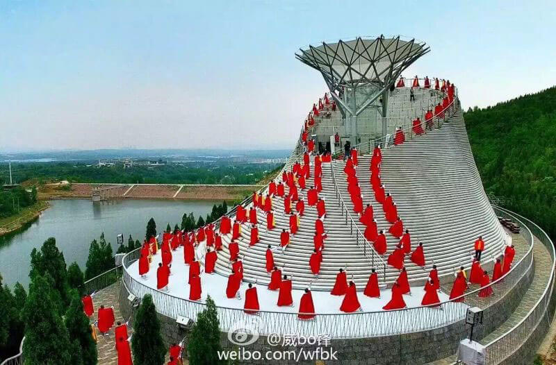 Performers surrounding Flying Dream in China