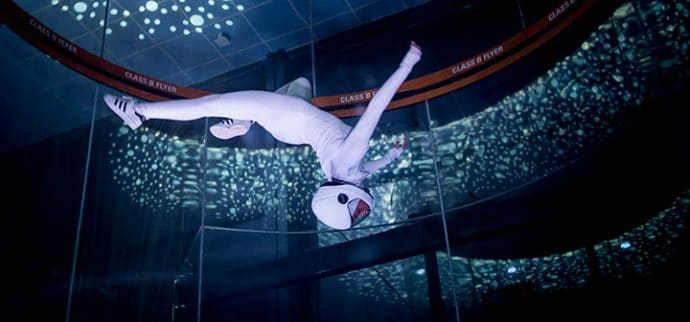 Dancer flying in the tunnel in all white